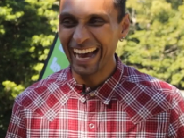 Omar in a red shirt laughing