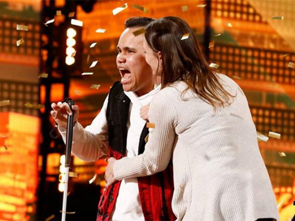 Kodi Lee covered in gold pieces winning the golden buzzer